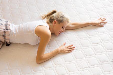 Woman enjoying her new comfortable mattress